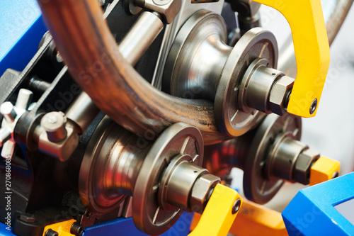 Foto industrial tube bender equipment machine for metal pipe bending.