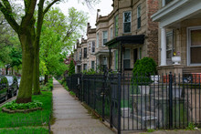 Row Of Old Fenced In Homes In Logan Square Chicago