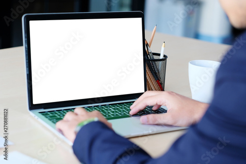 Fotografia  Man hands typing laptop computer with blank screen for mock up template backgrou