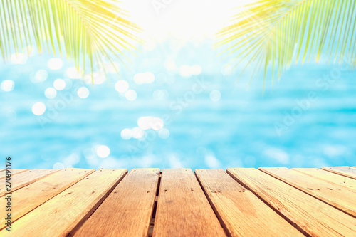 Foto auf Gartenposter Strand Selective focus of old wood table with beautiful beach background for display your product.