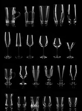 Set Of Different Empty Glasses On Black Background