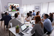 canvas print picture - Businesspeople Attending Videoconference Meeting In Office
