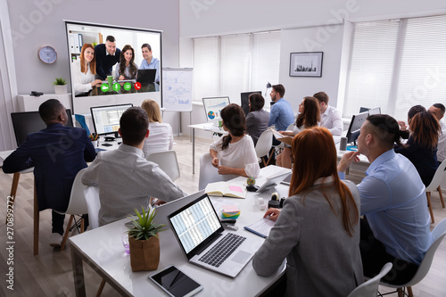 Businesspeople Attending Videoconference Meeting In Office - 270899272