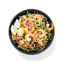 Stir Fry Noodles With Shrimps And Vegetables In Black Bowl Isolated On White Background.