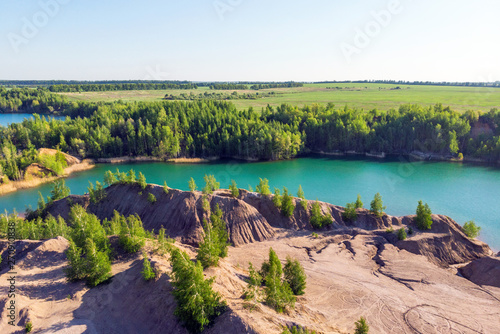 Foto auf Leinwand Aubergine lila Aerial view of picturesque hills and blue lakes in Konduki, Tula region, Russia. Turquoise quarry in Romantsevo.