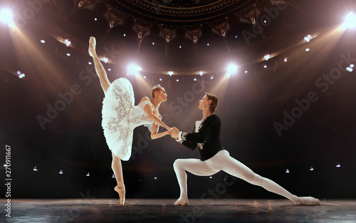 Ballet. Classical ballet performed by a couple of ballet dancers on the stage of the opera house. - 270911667