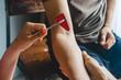 Leinwandbild Motiv Doctor testing biceps tendon reflex with red hummer jerk on young man arm.