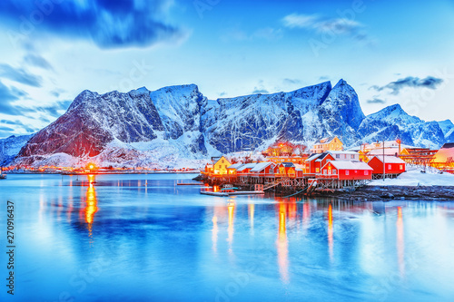 фотография Amazing dusk panorama of picturesque peaks of Reine village on Lofoten Islands Archipelago in Norway