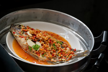 Steamed Fish With Lime And Garlic Recipe In Steamer Pot.