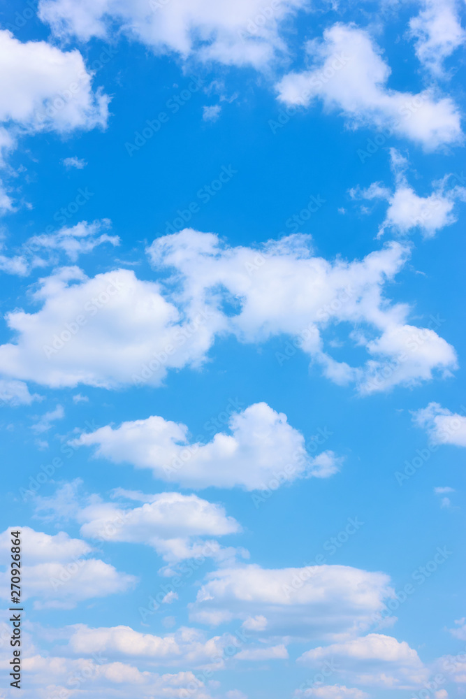 Fototapeta Beautyful blue sky with white clouds -  vertical background