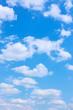 Leinwandbild Motiv Beautyful blue sky with white clouds -  vertical background