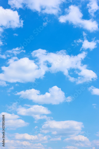 Fototapeta Beautyful blue sky with white clouds -  vertical background obraz