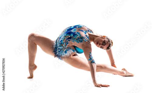 Girl doing rhythmic gymnastics with ball .