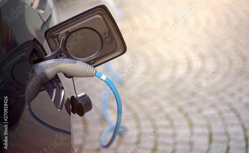 Electric car being charged. Horizontal image with copy space.  - 270928426