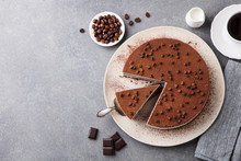 Tiramisu Cake With Chocolate Decotaion On A Plate. Grey Stone Background. Top View. Copy Space.