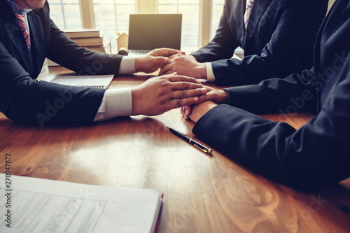 Businessman consoling his friends after failing to do business. Canvas Print