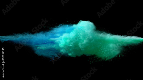 Collision of colored powder isolated on black Canvas