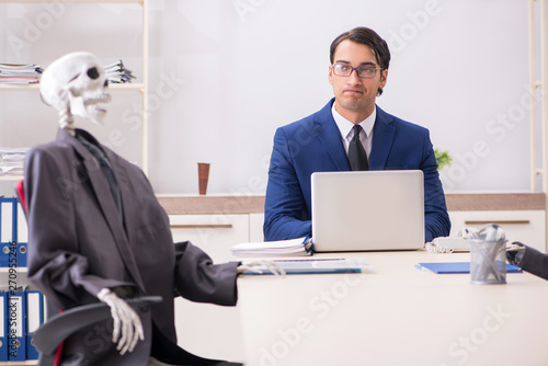 Funny business meeting with boss and skeletons