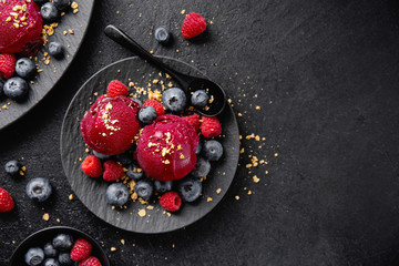 Berry refreshing ice cream scoops on plate