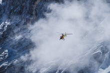 Helicopter In Flight Into Clou...