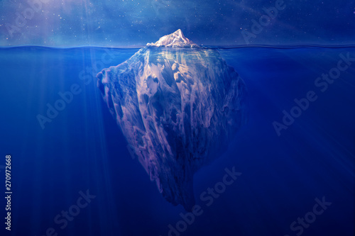 Fotografie, Obraz  Iceberg floating in the ocean at night with visible underwater part