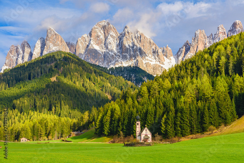Sunny landscape of Dolomite Alps. St Johann Church with beautiful Dolomiti mountains, Santa Maddalena
