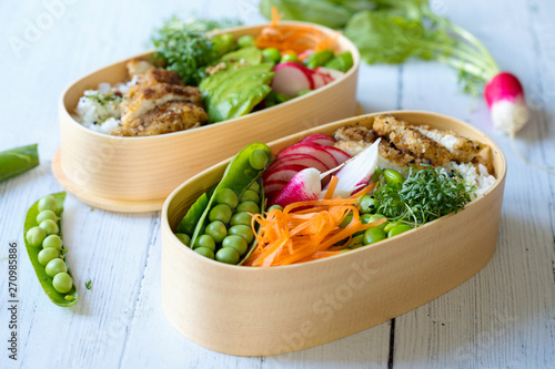 Japanese style bento lunch box with chicken, rice and vegetables Wallpaper Mural