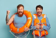 Two Men Lifeguards Use Lifelin...
