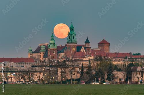 Fototapeta Wawel Castle and full moon, Krakow, Poland, seen from Blonia meadow obraz