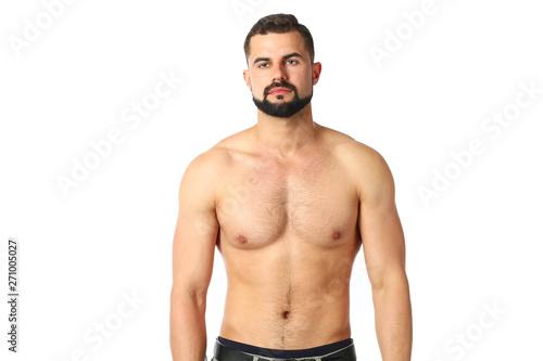 Obraz na płótnie Portrait of a happy athletic man with muscular torso standing