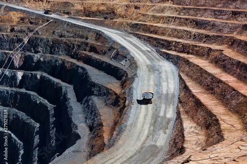 Fotografia, Obraz  Two trucks transport gold ore from open cast mine