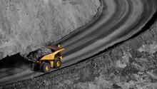 Modern Gold Mine In Kalgoorlie, Western Australia. Large Truck Transports Gold Ore From The Super Pit, Open Cast Mine.