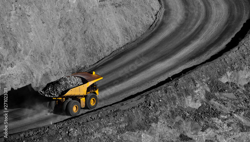 Modern Gold Mine in Kalgoorlie, Western Australia. Large truck transports gold ore from the Super Pit, Open cast mine. - 271023011