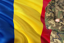 Crossed Arms Romanian Soldier With National Waving Flag On Background - Romania Military Theme.