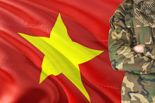 Crossed Arms Vietnamese Soldier With National Waving Flag On Background - Vietnam Military Theme.
