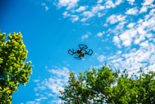 Flying Drone Quadcopter And Blue Sky
