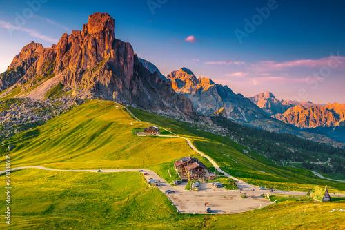 Valokuva  Stunning alpine pass with high mountains at sunset, Dolomites, Italy