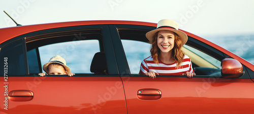 Fotografia, Obraz  happy family mother and child boy goes to summer travel trip in car
