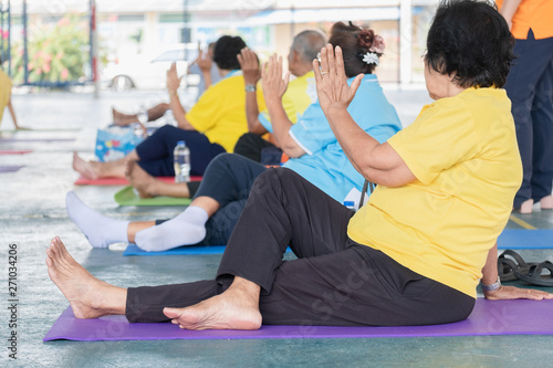 Fototapety, obrazy: Elderly in a yoga exercise posture
