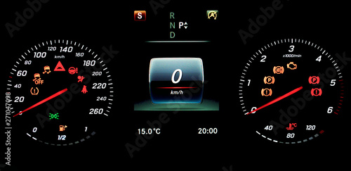Check Tpms System >> A Car Instrument Panel With Speedometer Tachometer