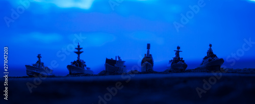 Military navy ships in a sea bay at sunset time. Selective focus Wallpaper Mural