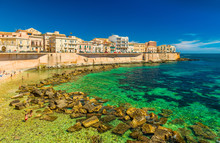 Cityscape Of Ortygia. City Beach In The Historical Center Of Syracuse, Famous Place On Sicily, Italy