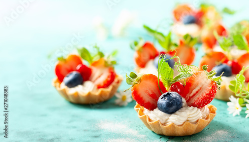 fototapeta na szkło Summer berry tartlets with cream and fresh berries.