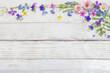 Leinwandbild Motiv beautiful flowers on wooden background