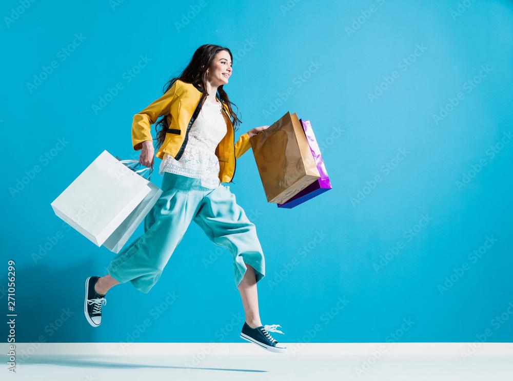Fototapeta Cheerful happy woman enjoying shopping