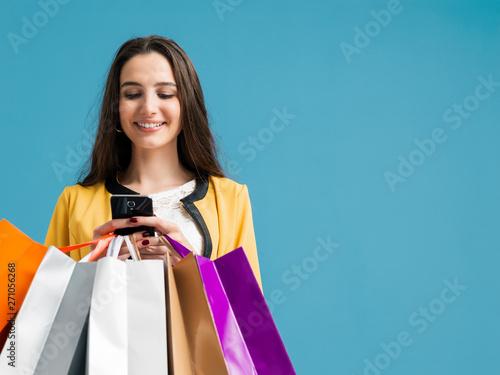 Fototapeta Happy woman using shopping apps obraz