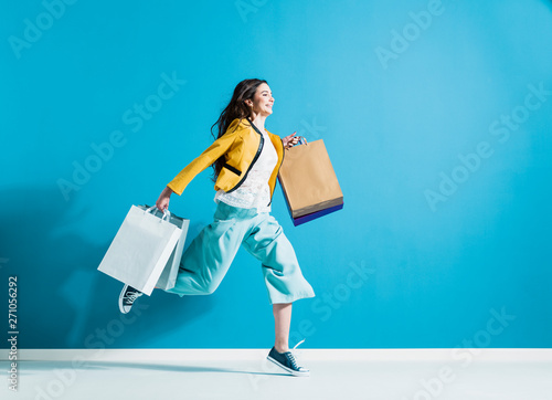 Fototapety, obrazy: Cheerful happy woman enjoying shopping