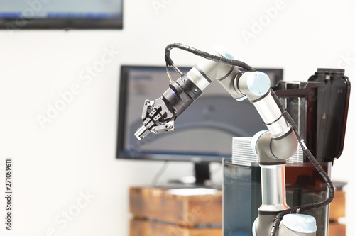 Foto Industrial pick and place, insertion, quality testing or machine tending robot a
