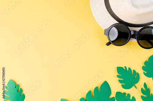 Fototapeta Top view of summer concept with sunglasses and hat on yellow background obraz na płótnie