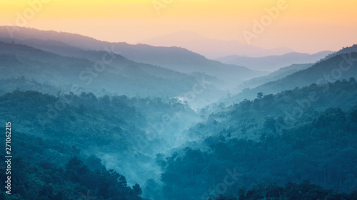 Foto auf Leinwand Blau türkis earth day and environment care travel concept from beautiful landscape of tropical forest with haze with soft focus of layer mountain background